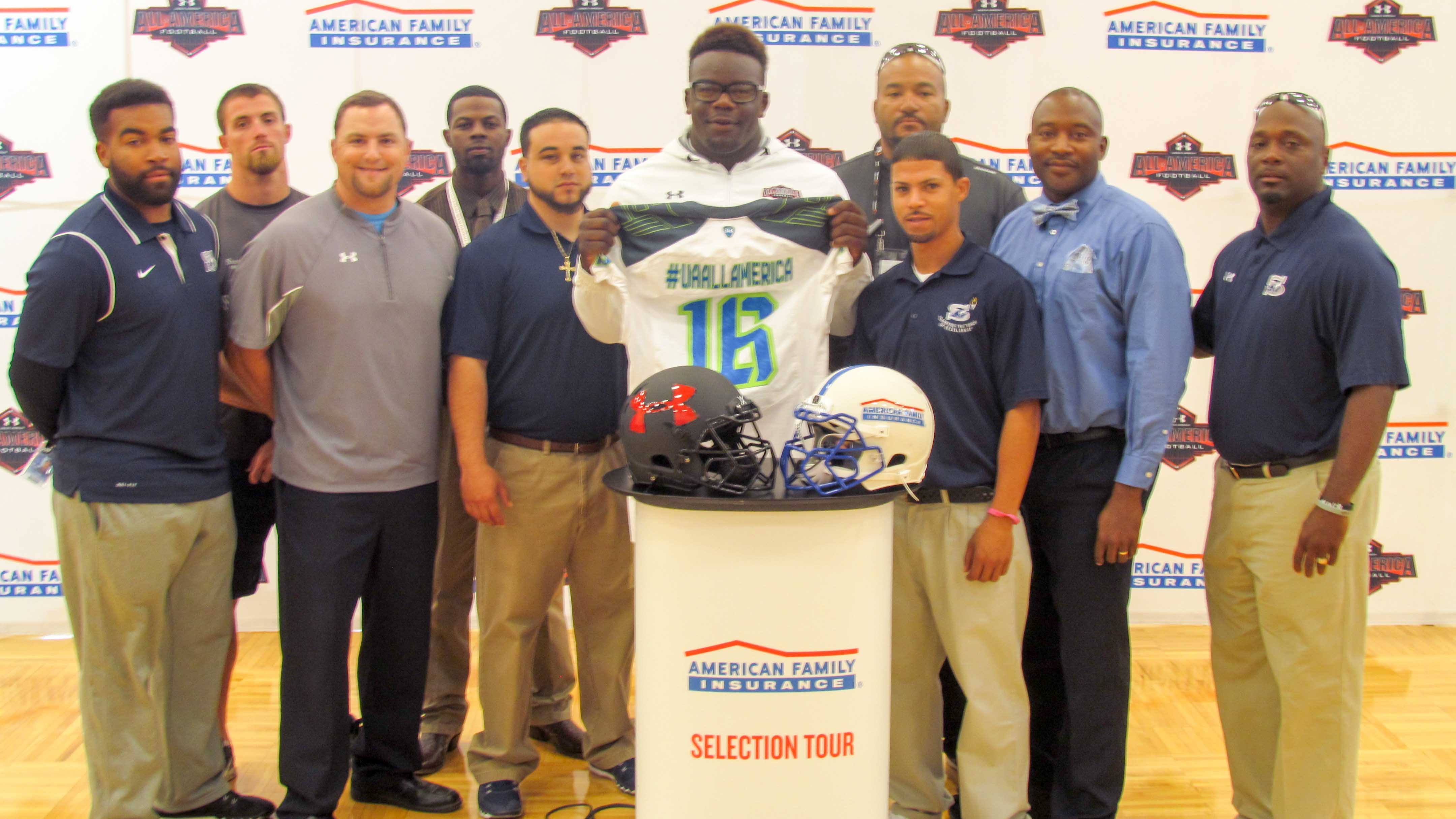 Kendell Jones is surrounded as he shows off his Under Armour All-America jersey (Photo: Intersport)