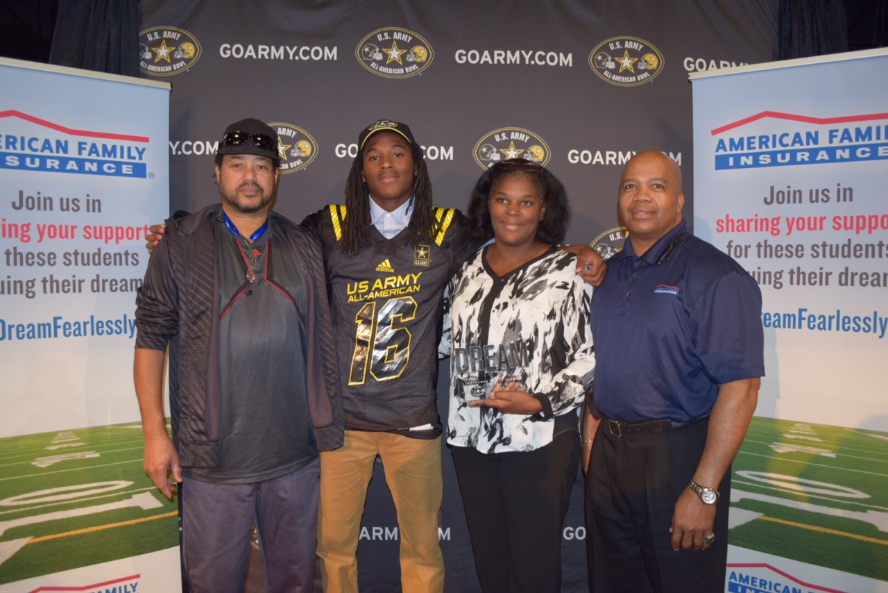 Marquez Callaway presents the Dream Award to his parents Antonio (left) and Maureen Callaway. (Photo: Army All-American Game)