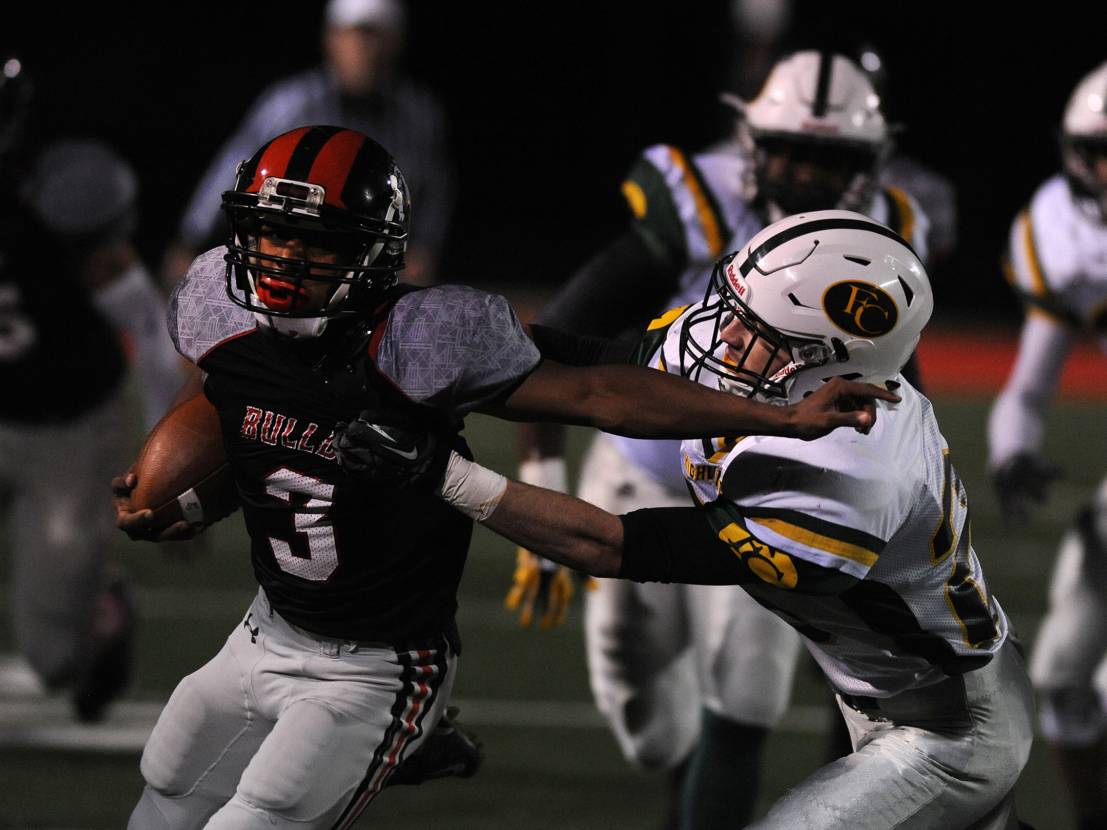 New Albany's Rondale Moore (3) fights for yardage against Floyd Central on Friday at New Albany High School. Photo by David Lee Hartlage/Special to the Courier-journal. Oct. 16, 2015