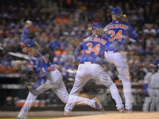 Multiple exposure image of Noah Syndergaard (34) throwing a pitch against the Chicago Cubs in game two of the NLCS at Citi Field. (Photo: Robert Deutsch, USA TODAY Sports)