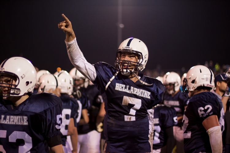 Quarterback Christian Moore signals the victory on the scoreboard. Photo by Matthew Boyle