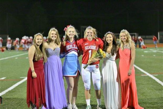 Seaside (Ore.) senior placekicker Whitney Westerholm accepts her homecoming queen crown at midfield. (Jeff TerHar/The Daily Astorian via Associated Press)