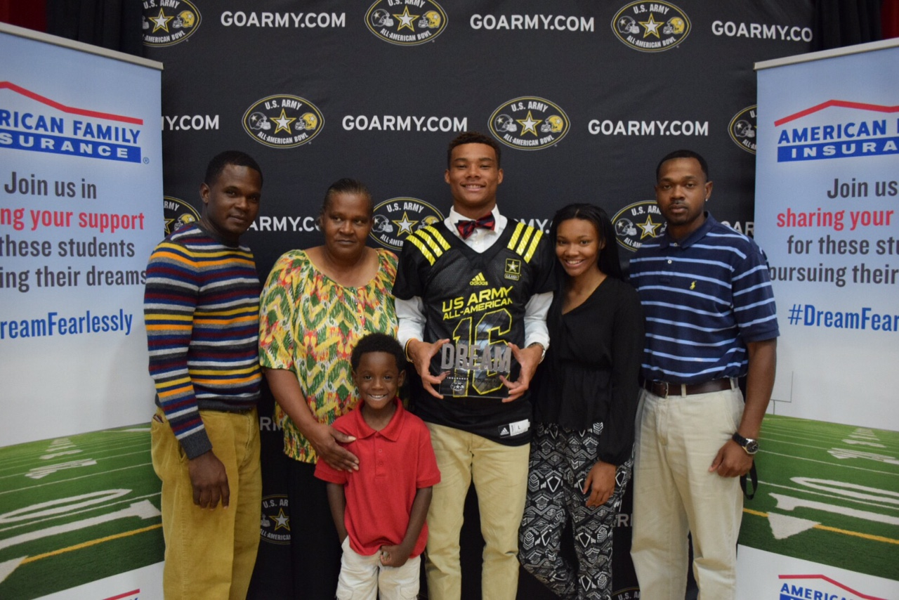 Savannah Christian football player Demetris Robertson, center, with his family Monday at his jersey presentation for the U.S. Army All-American Bowl. (Photo: U.S. Army All-American Bowl).