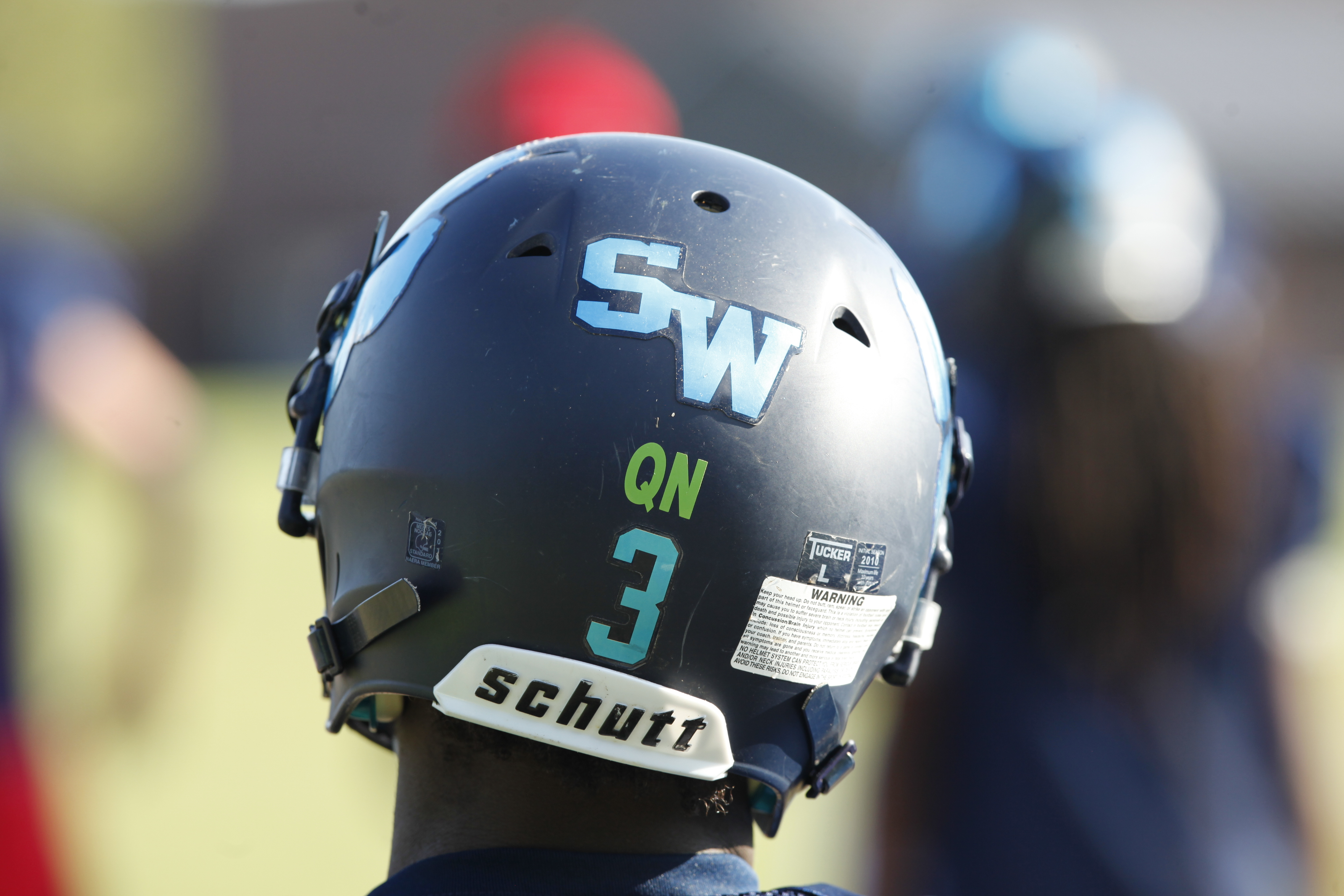 Teammates of Quontellas Norwood all wear the initials of Norwood on their helmets. (Photo: Mark Dolejs, USA TODAY Sports)