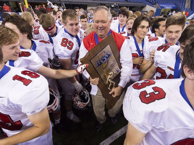 Center Grove High School head coach Eric Moore celebrates with his team after winning the IHSAA Class 6A state championship (Photo: Doug McSchooler / For The Indianapolis Star)