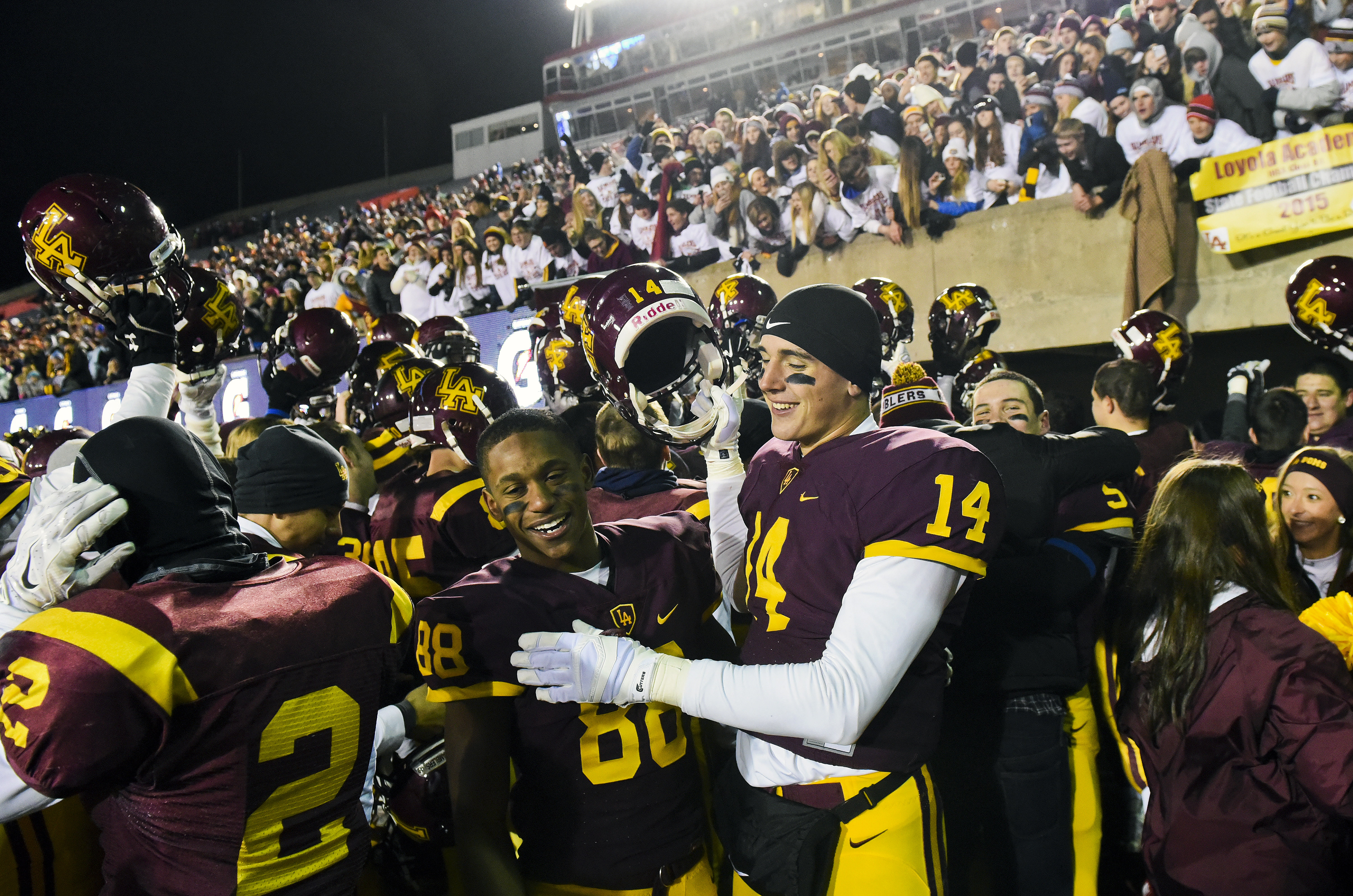 Loyola Academy's Eric Eshoo (88) and Jake Marwede (14) celebrate after beating Marist 41-0 in the IHSA Class 8A high school championship game (Matt Marton, Associated Press)