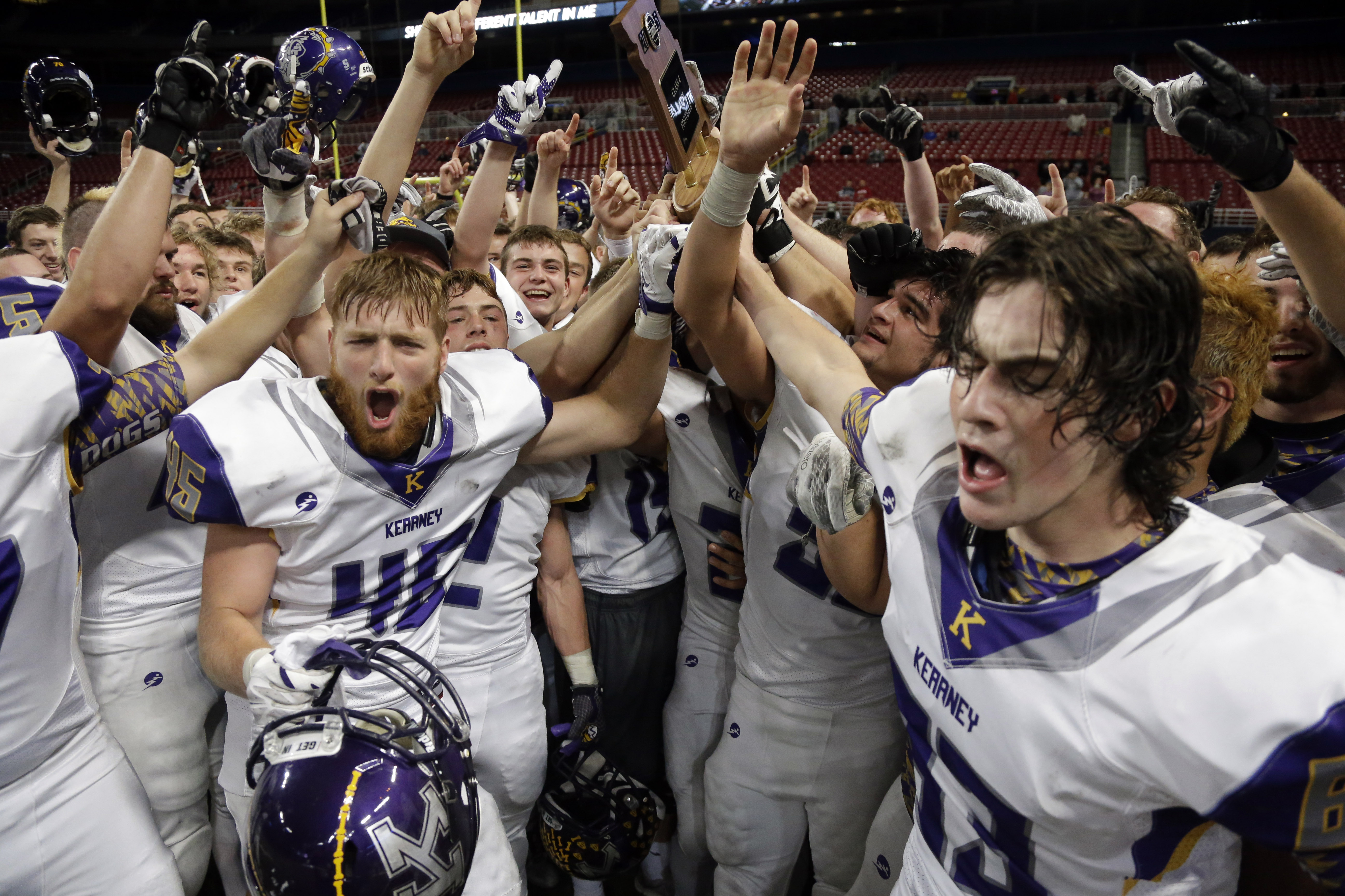 Members of the Kearney Bulldogs celebrate after defeating Webb City in the Missouri Class 4 state high school football championship (Photo: Jeff Roberson, Associated Press)