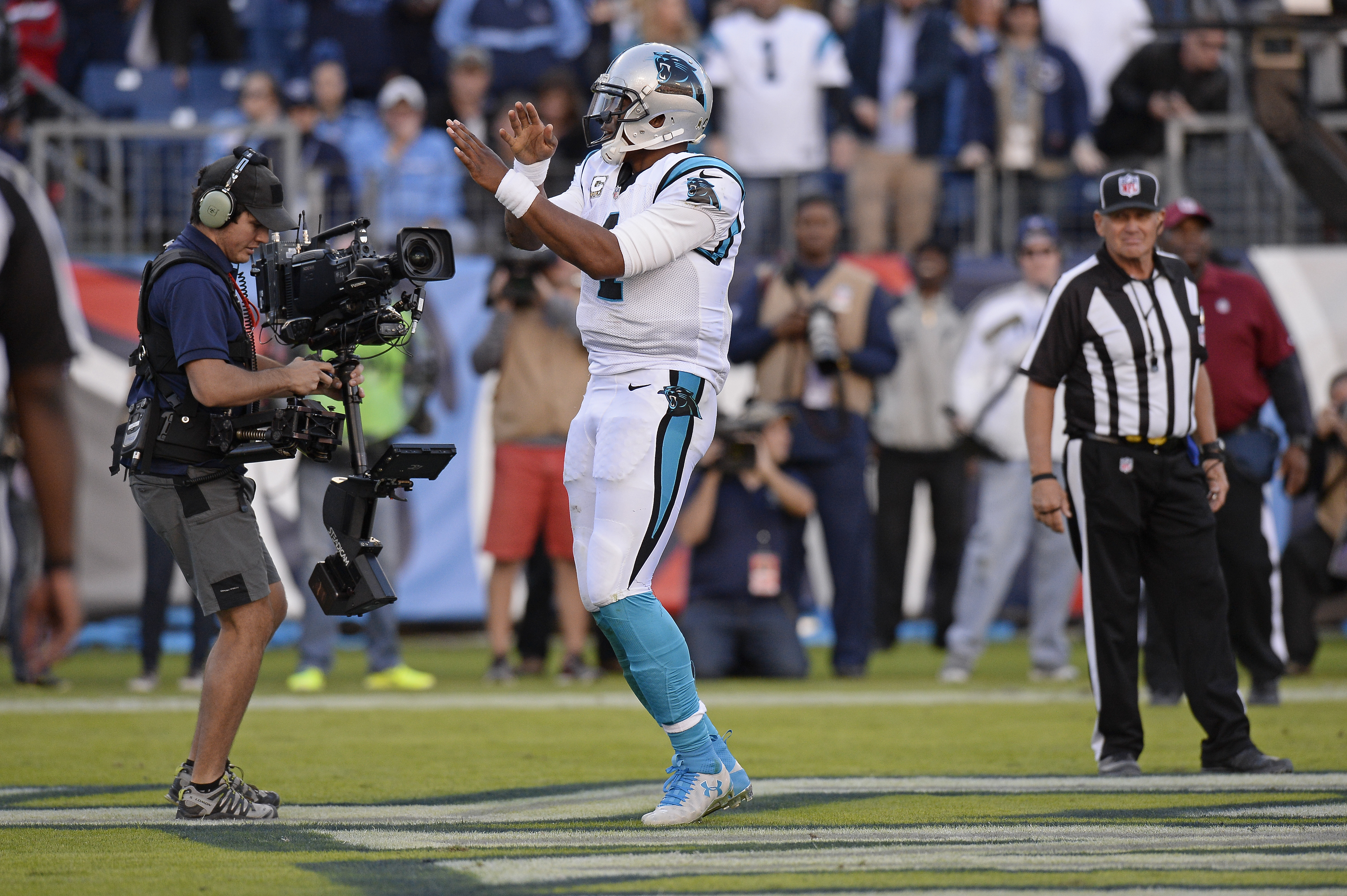 Carolina Panthers quarterback Cam Newton dances after scoring a touchdown against the Tennessee Titans (Photo: Associated Press)