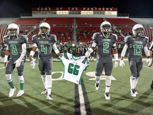 Collins players carry the jersey of Jabarri Goudy (66) before the game against Philadelphia at Petal High on Nov. 6. Goudy was killed in a shooting outside a Hattiesburg nightclub in July. (Photo: Eli Baylis, Hattiesburg American)