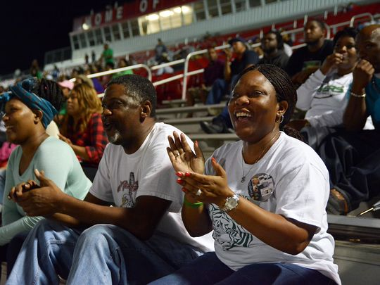 Montoyia McInnis, right, mother of former Collins High football player Jabarri Goudy, looks on during the Tigers' first-round playoff game Nov. 6. Goudy was killed in a shooting in July outside Club Memories in Hattiesburg. (Photo: Eli Baylis, Hattiesburg American)