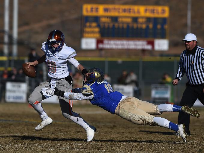 Bishop Gorman's Tate Martell tries to elude a tackle against Reed (Photo: Jason Bean, Reno Gazette Journal)