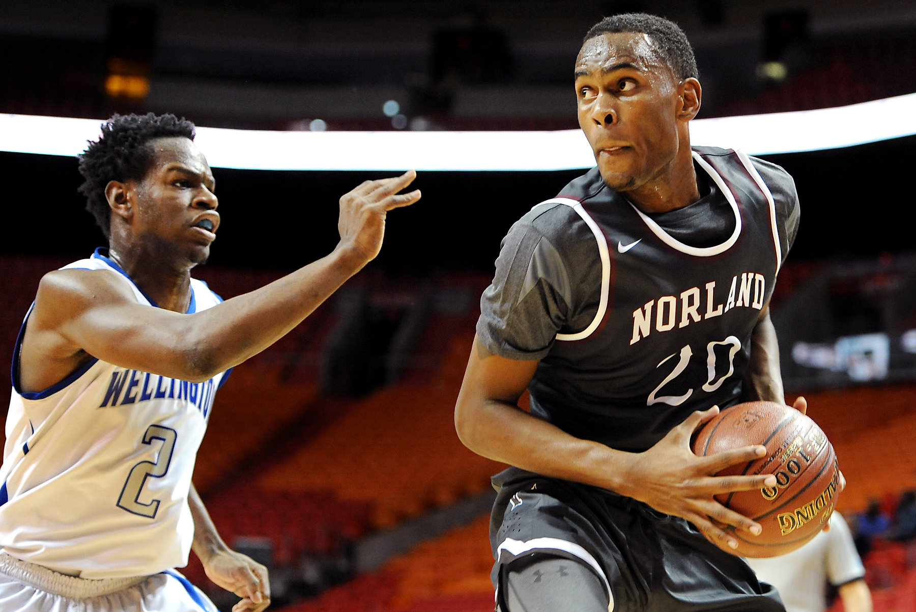 Dewan Huell (20) spins and turns while defended by Wellington's Alex Dieudonne (Photo: Robert Duyos, USA TODAY Sports)