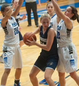 Charlestown Pirates' Bri Harvey, left, and Pirates' Erin Krimbrell, right, surround Providence Pioneers' Lexie Libs in the 40th annual Charlestown Gir'ls Basketball Holiday Tourney. 22 December 2015