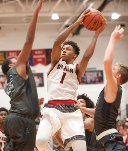 New Albany Bulldogs guard-forward Romeo Langford puts up a shot as he is defended by Reitz Panthers center Jyrus Freels, left, and Panthers guard Isaiah Dunham, right. 30 December 2015