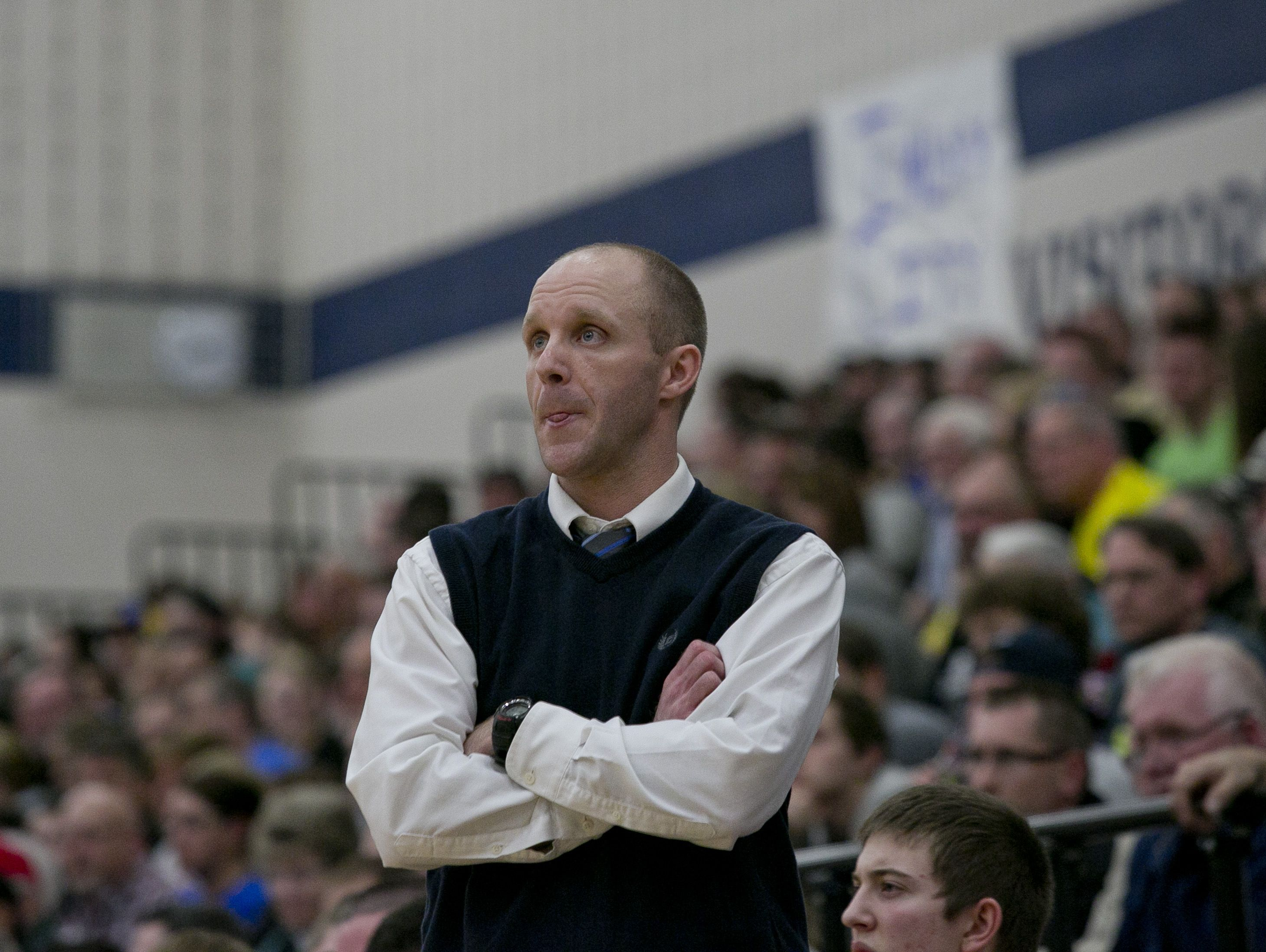 Yale coach Garnett Kohler bites his tongue as he watches the action from the sidelines during a Class B district basketball game Friday, March 13, 2015 at Richmond High School. Yale beat Imlay City 59-43.