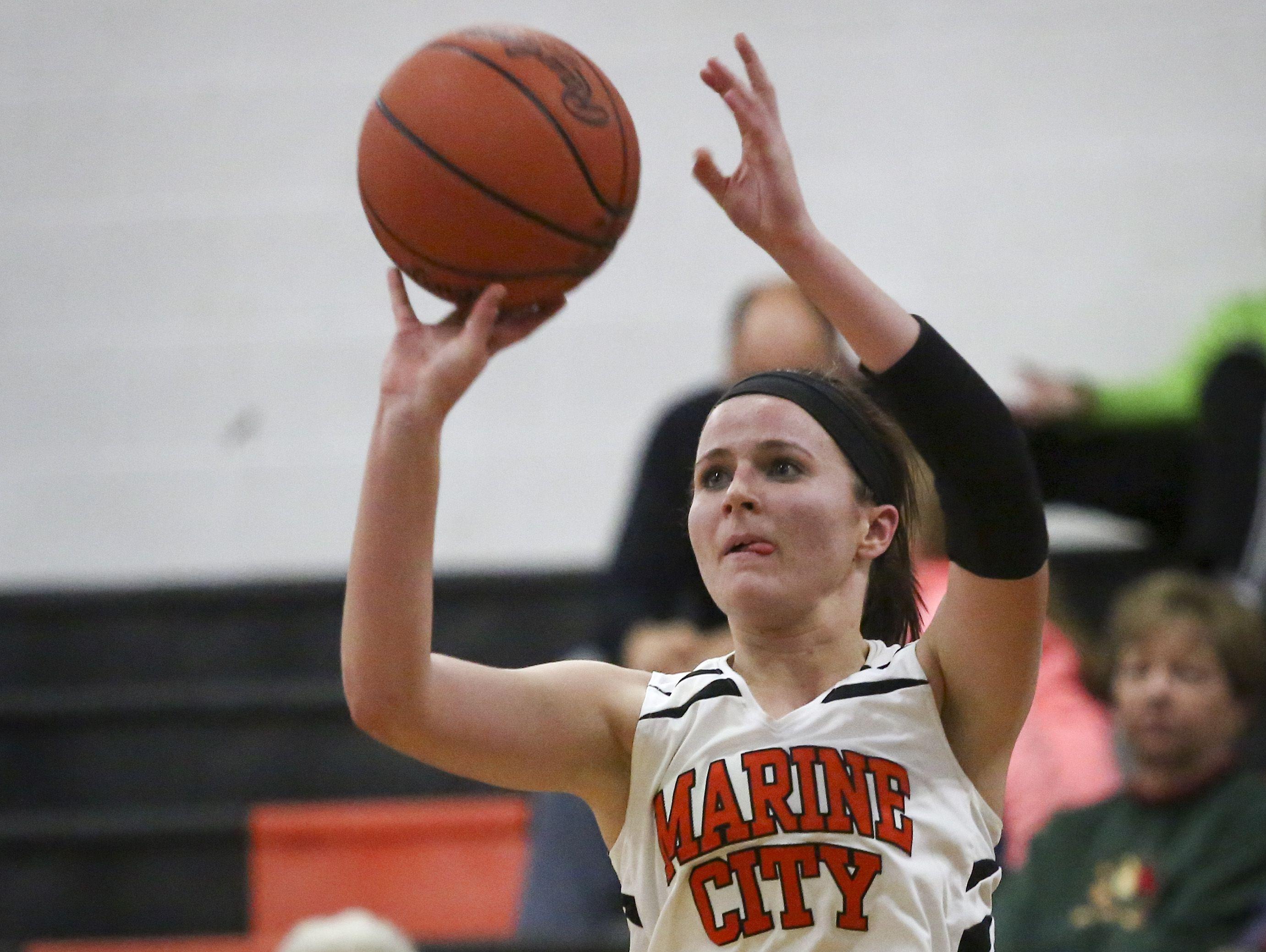 Marine City's Karyssa Austin takes a shot during a basketball game Tuesday, December 1, 2015 at Marine City High School.