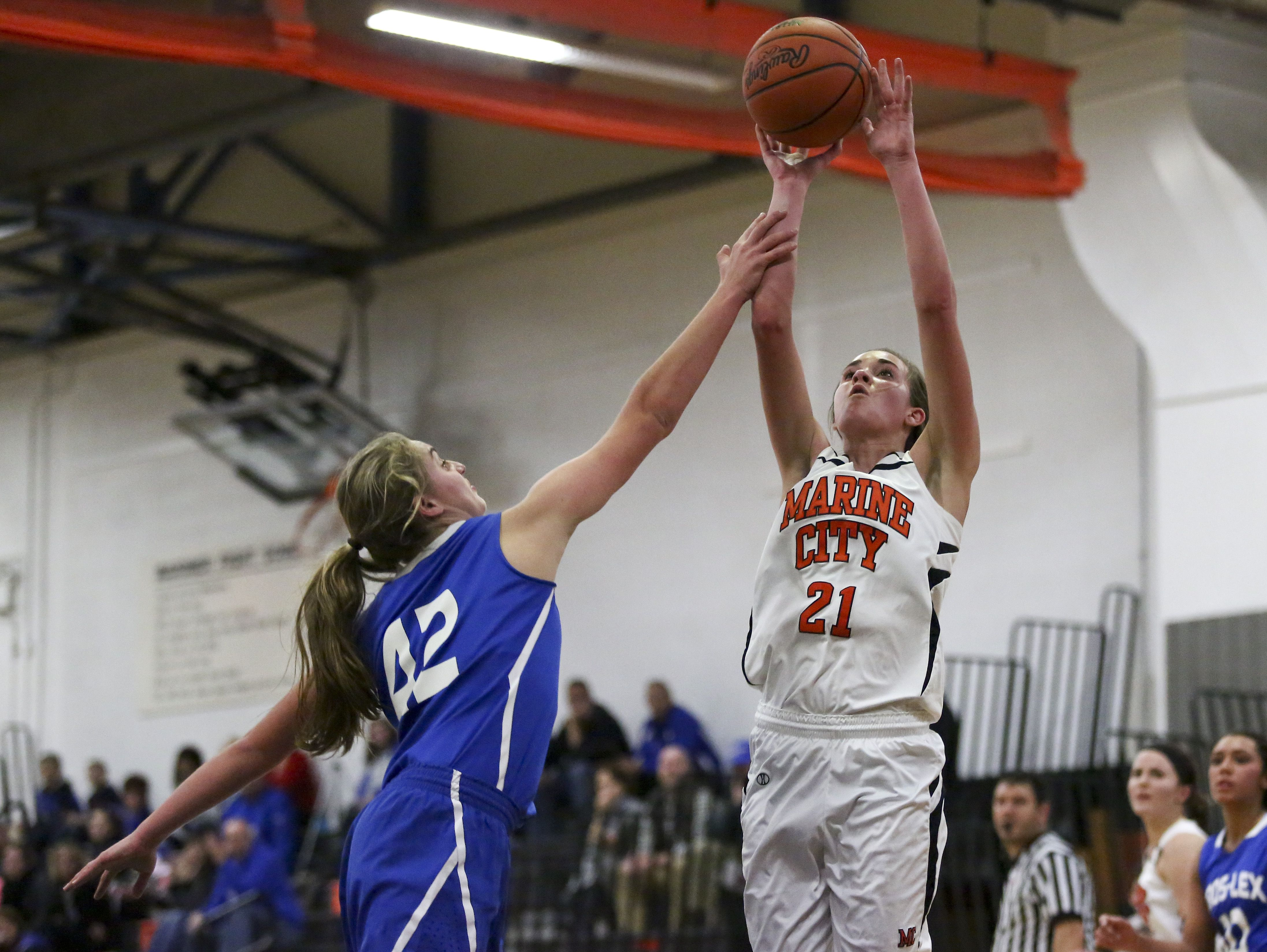 Marine City's Stephanie Abraham takes a shot over Cros-Lex's Rebecca Oden during a basketball game Tuesday, December 1, 2015 at Marine City High School.