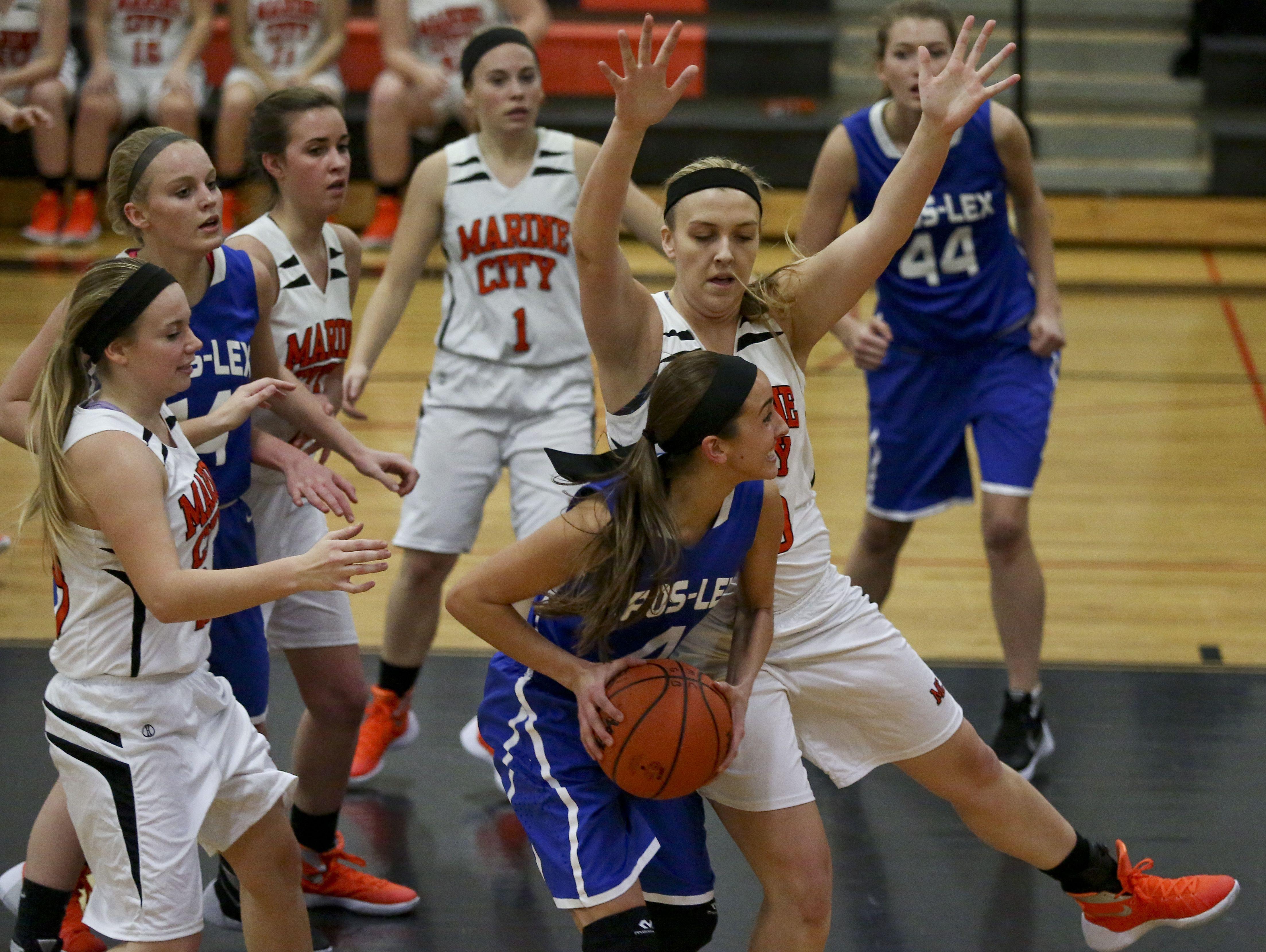 Marine City's Paige Tranchida blocks Cros-Lex's Rachel Soper during a basketball game Tuesday, December 1, 2015 at Marine City High School.