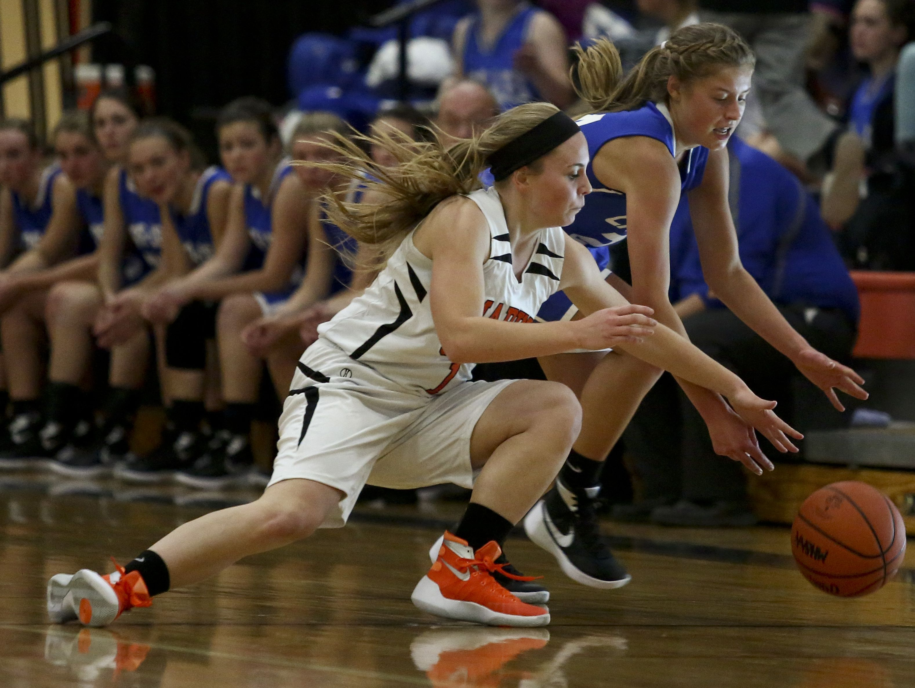 Marine City's Antonia Potvin and Cros-Lex's Calli Townsend fight for possession of a loose ball during a basketball game Tuesday, December 1, 2015 at Marine City High School.