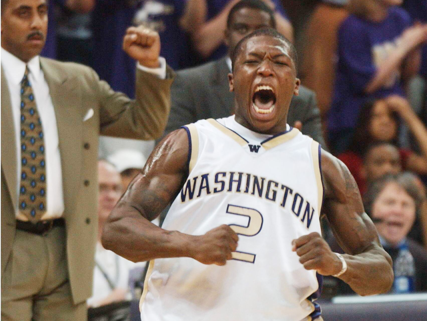 Nate Robinson of the Washington Huskies celebrates near the end of the game against the Oregon Ducks on February 22, 2003 at Bank of America Arena in Seattle Washington. The Huskies beat the Ducks 78-66.