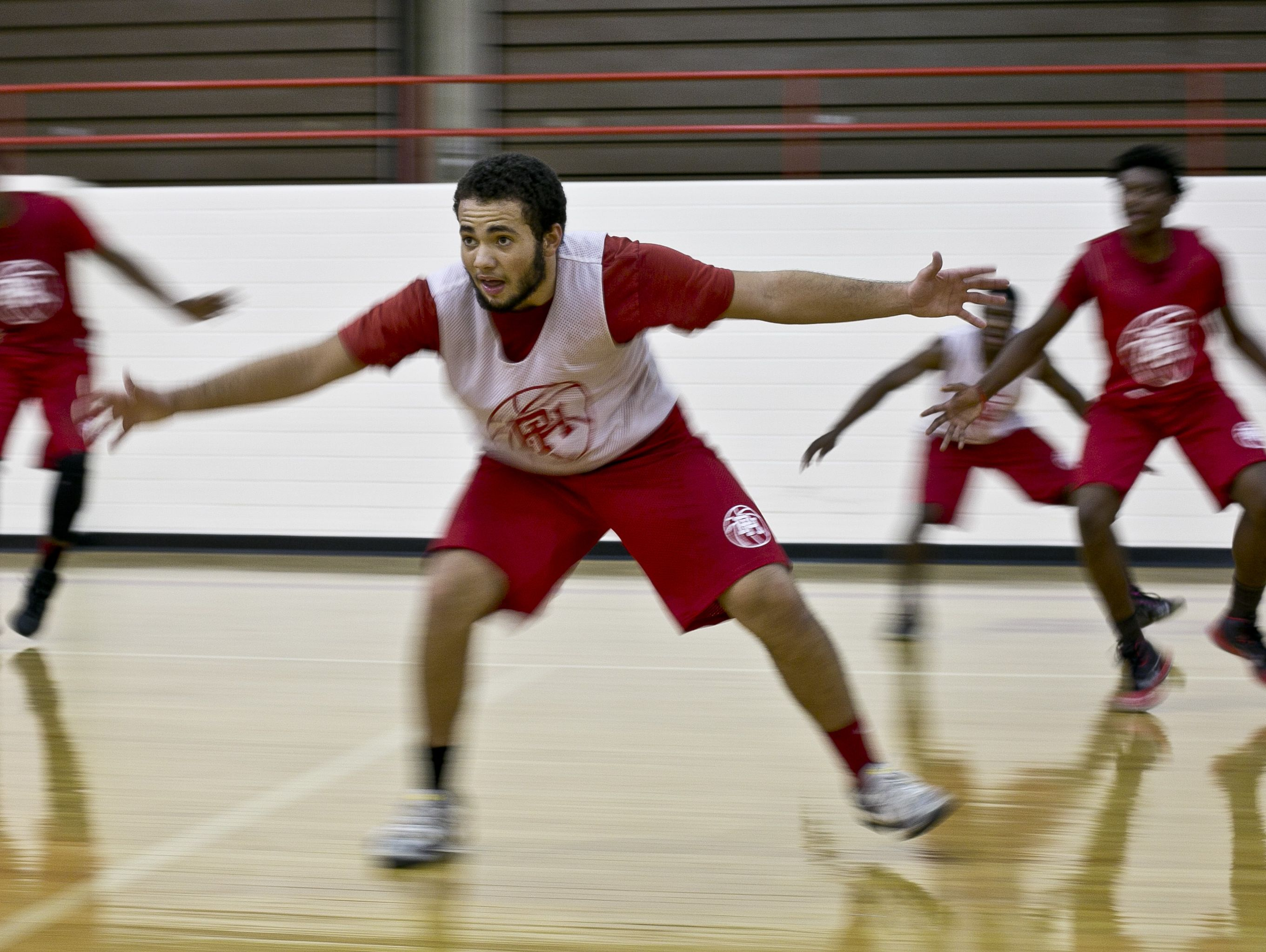 Port Huron senior Nate Rogan runs side-step drills with teammates during practice Thursday, December 3, 2015 at Port Huron High School.