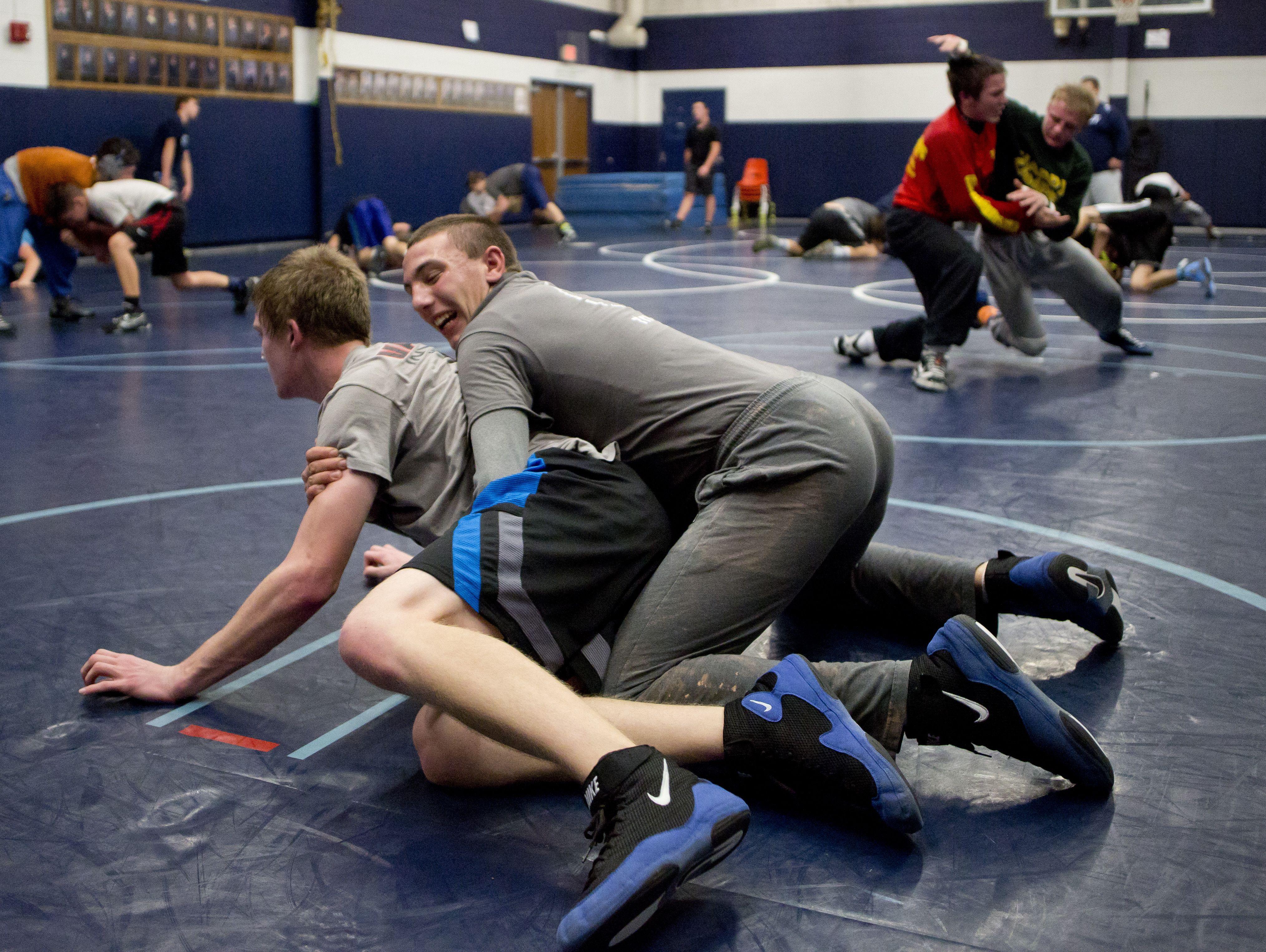 Richmond freshman Ethan Wyatt and sophomore David kaltz wrestle during wrestling practice Friday, Dec. 4, 2015 at Richmond High School.