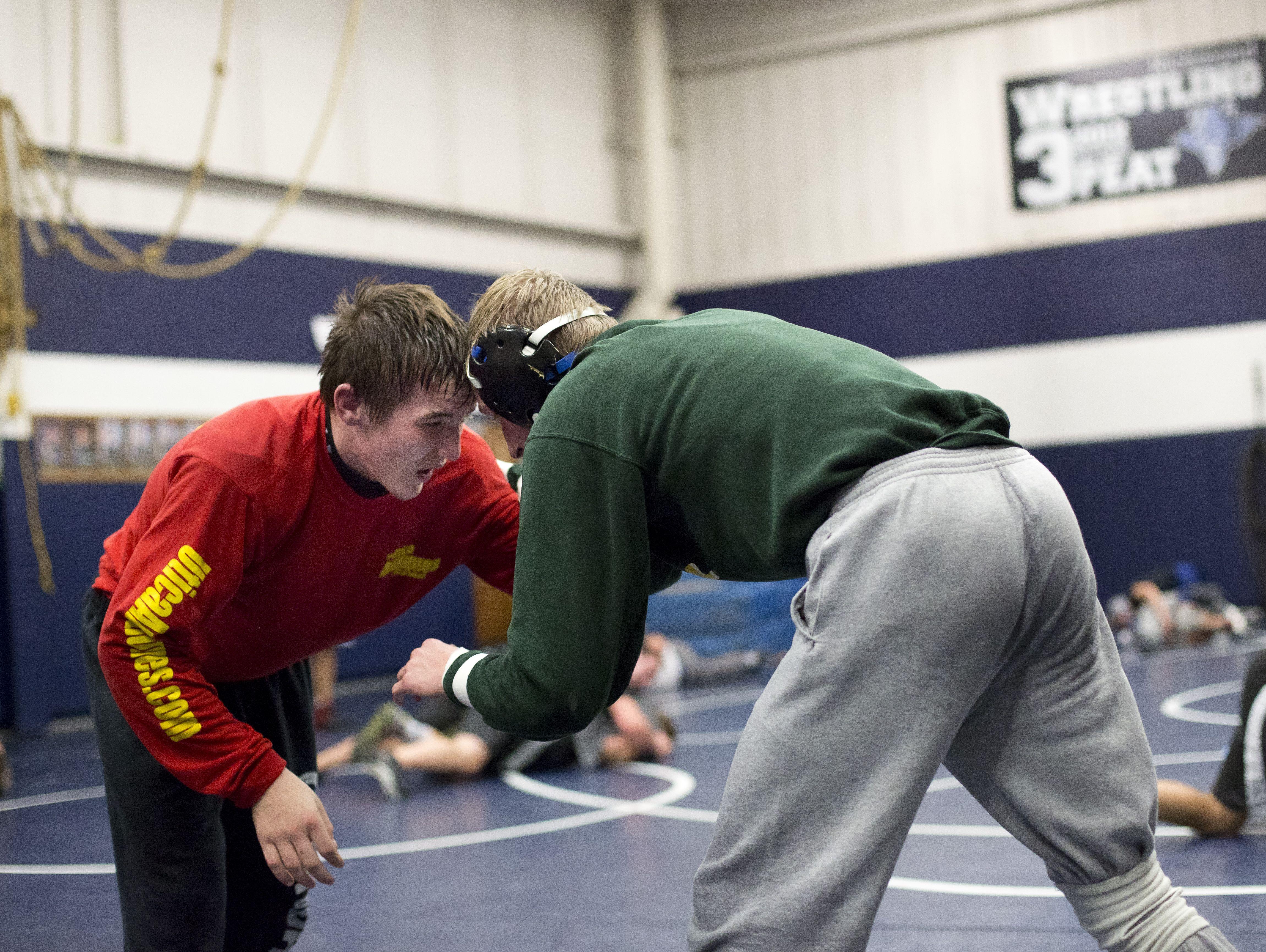 Richmond freshman Eric Barr and senior Graham Barton wrestle during wrestling practice Friday, Dec. 4, 2015 at Richmond High School.