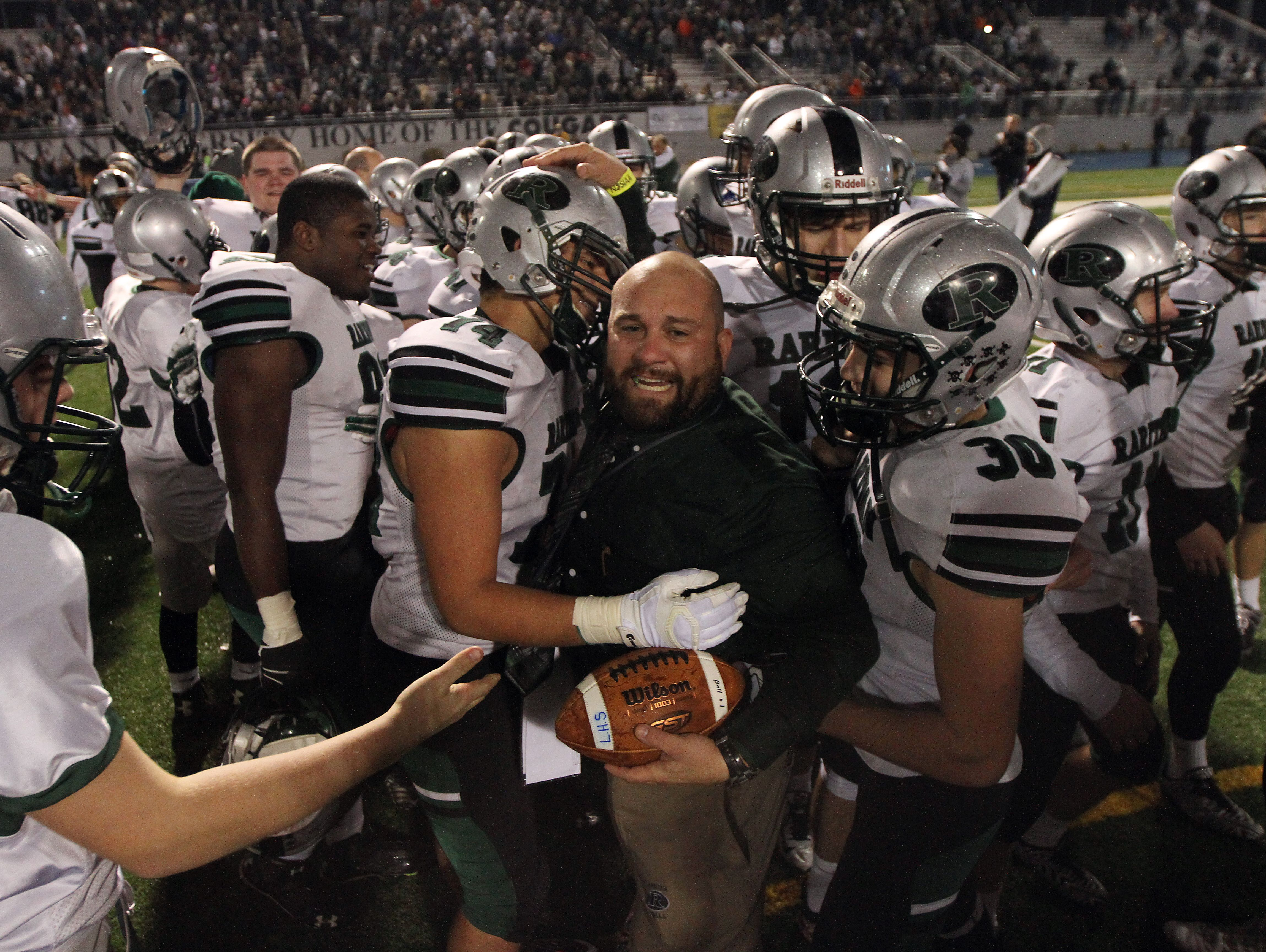 The run by the Raritan players, shown with head coach Anthony Petruzzi (center) celebrating the NJSIAA Central Group II championship, was one of the many highlights of the 2015 Shore Conference scholastic football season.