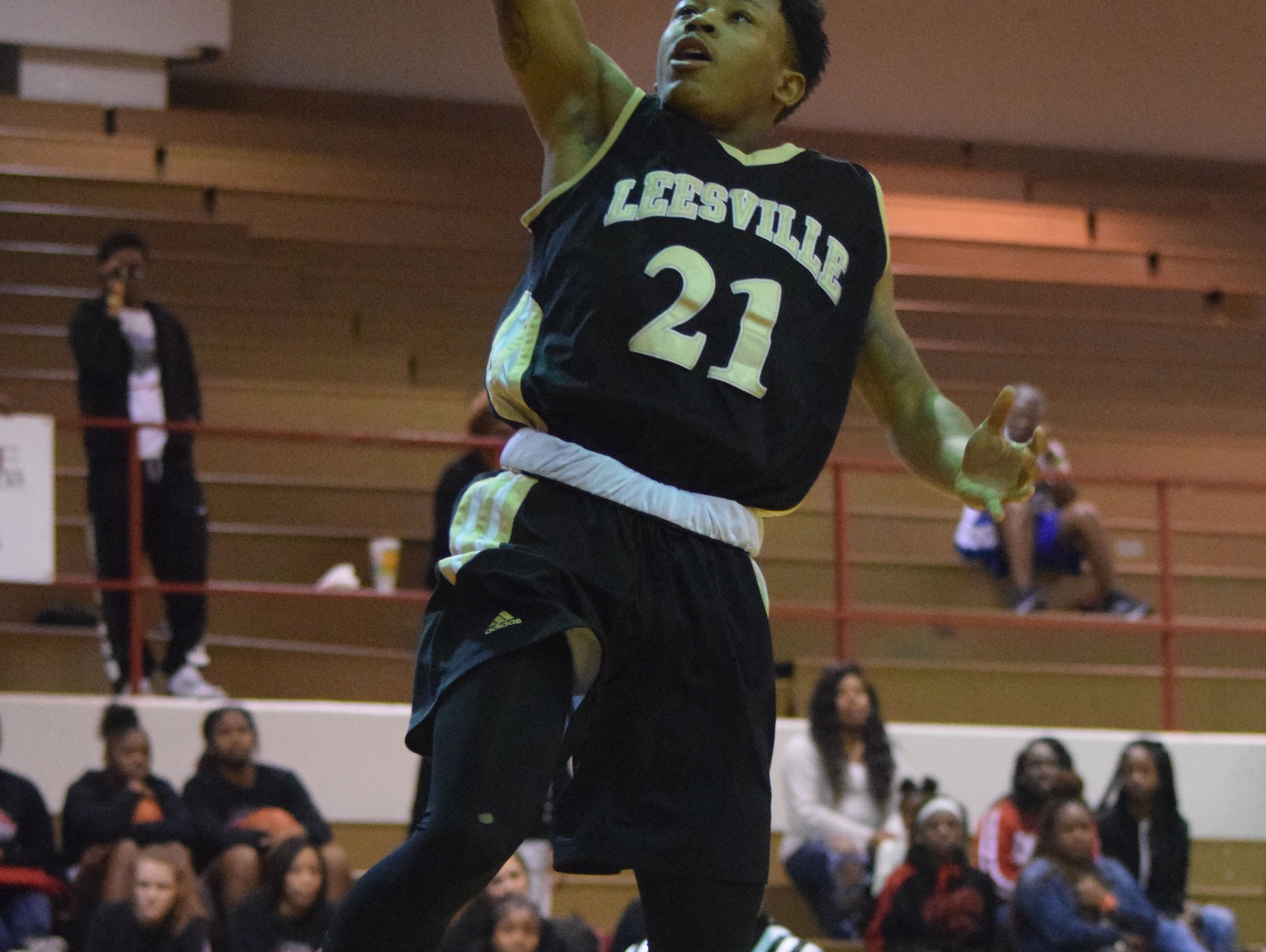 Leesville's DaQuan Smith (21, right) goes for two against Winnfield Thursday at Pineville High School.