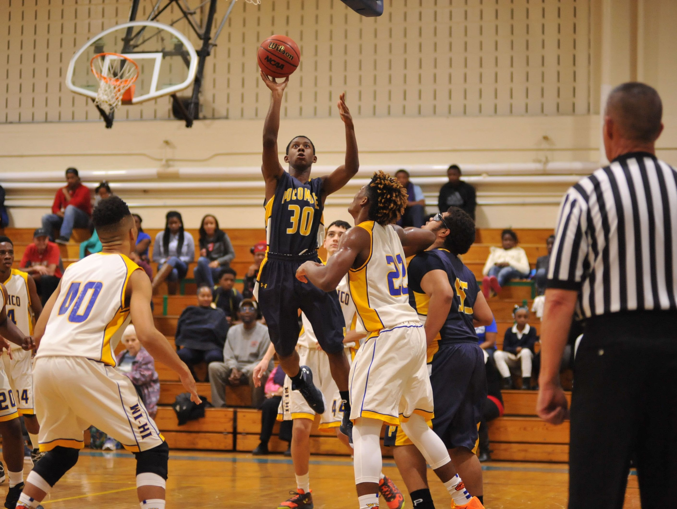 Pocomoke's Jameel Baldwin with the jumper against Wi-Hi on Thursday, December 10. at Wicomico High School.
