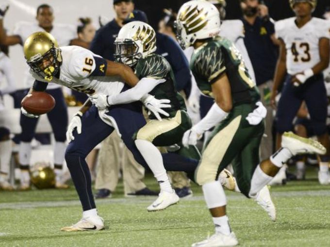 Trevon Grimes of St. Thomas Aquinas catches as pass in front of Malek Folston (6) and Evan Cruz of Viera during the second quarter. (Photo: Craig Bailey, Florida Today)