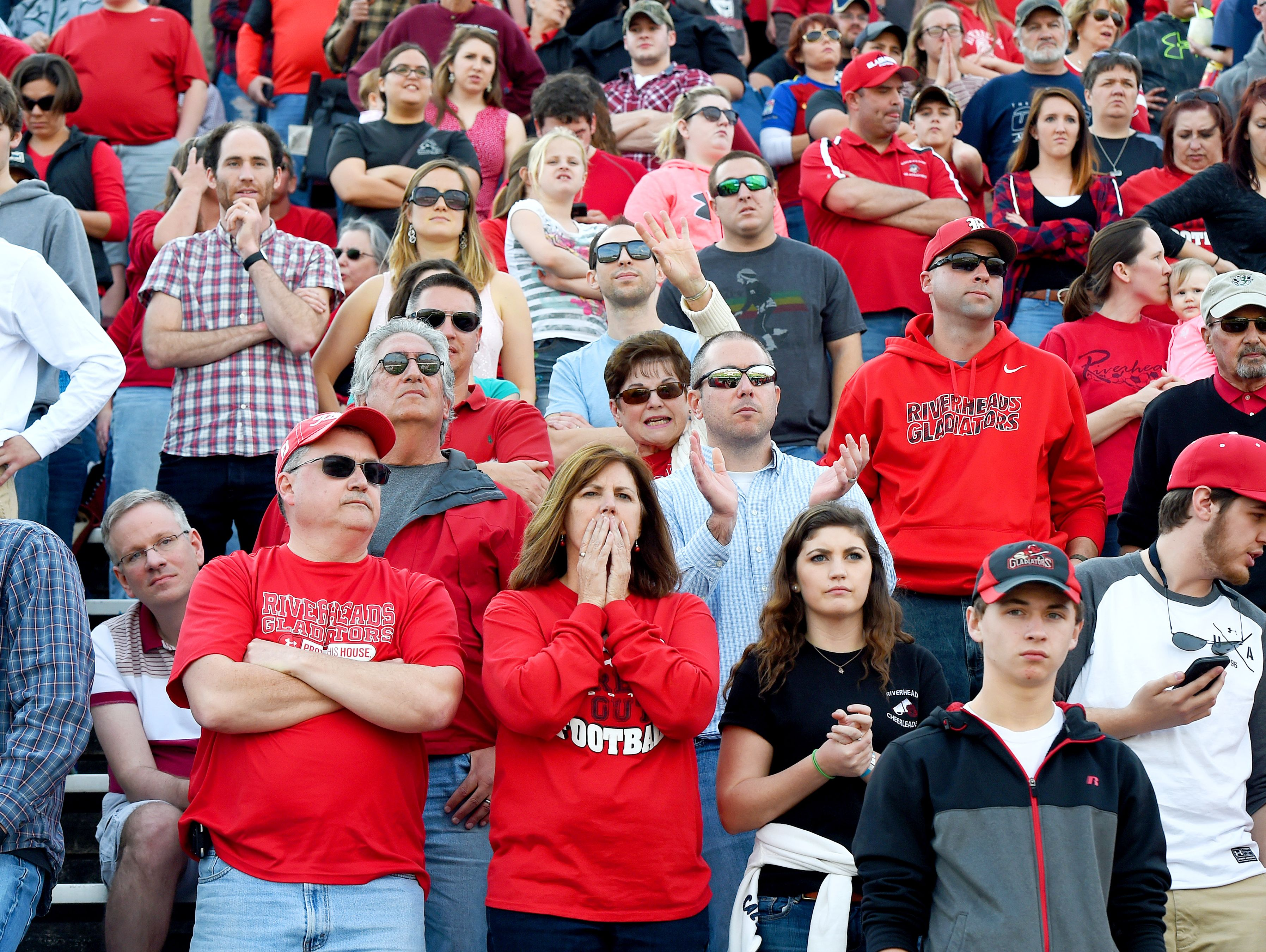 Riverheads' fans stand in relative silence as a two-point conversion fails and their team looses to Galax in the Group 1A football championship in Salem on Saturday, Dec. 12, 2015. Riverheads lost to Galax 7-6.