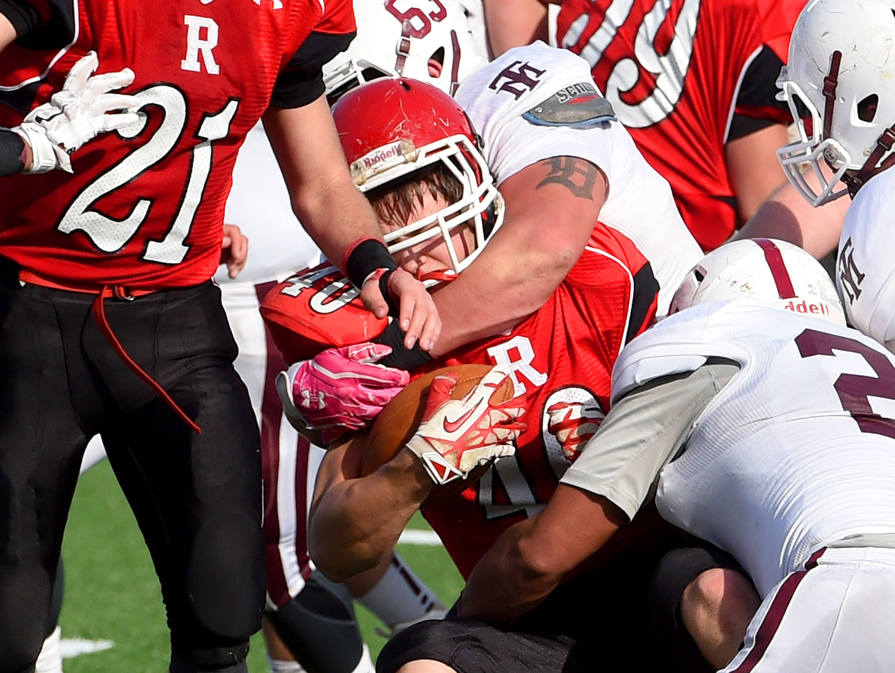 Riverheads' Harrison Schaefer is wrapped up by the Galax defense and brought down during the Group 1A football championship in Salem on Saturday, Dec. 12, 2015. Riverheads lost to Galax 7-6.