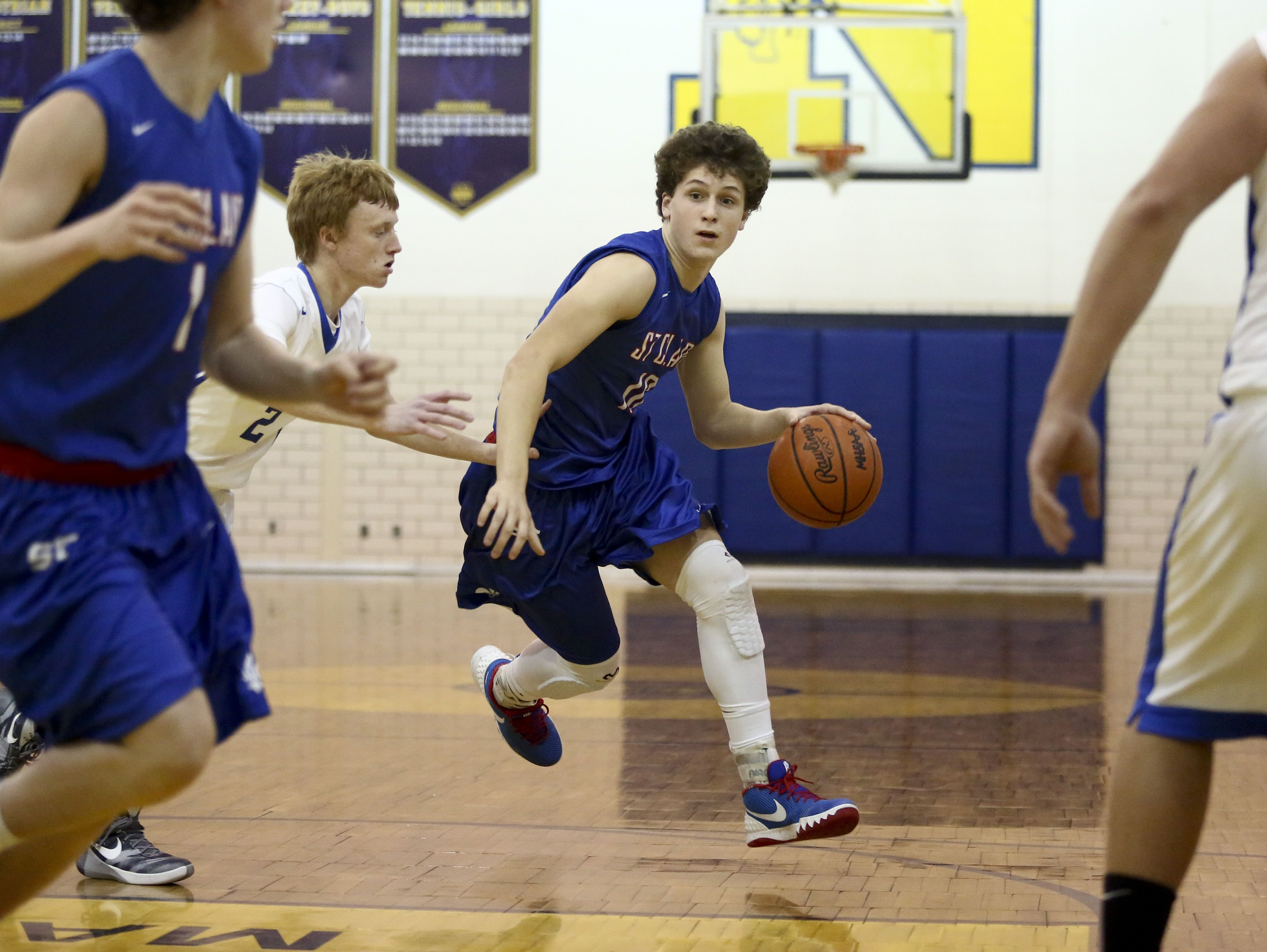 St. Clair sophomore Ben Davidson works the ball down court during the Ed Peltz Holiday Basketball Tournament Friday, Dec. 18, 2015 at Port Huron Northern High School.