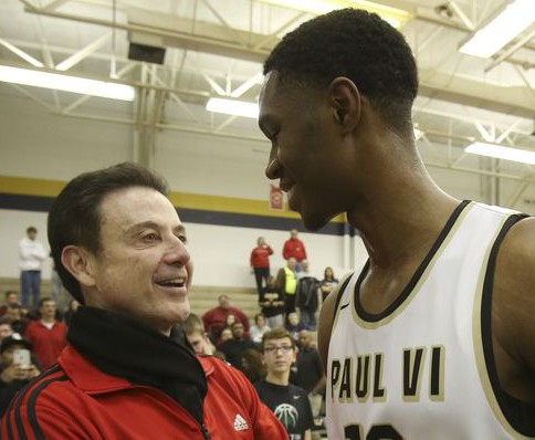 Louisville coach Rick Pitino greeted signee V.J. King, after his Paul VI Catholic High School squad defeated the North Bullitt High School in the King of the Bluegrass Tournament (Photo: Sam Upshaw Jr., Courier-Journal)