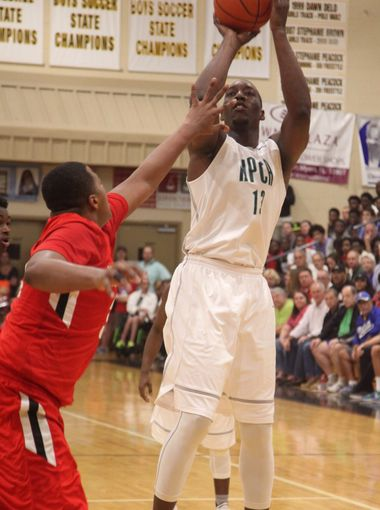 """High Point Christians Edrice """"Bam"""" Adebayo takes a shot over Westerville's Kaleb Wesson during the City of Palms quarterfinals on Monday night. (Photo: Jack Hardman, News Press)"""