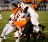 Imhotep Charter defenders gang tackle Cathedral Prep's Sullivan John during the first quarter (Photo: Charles Fox, Philadelphia Inquirer via Associated Press)
