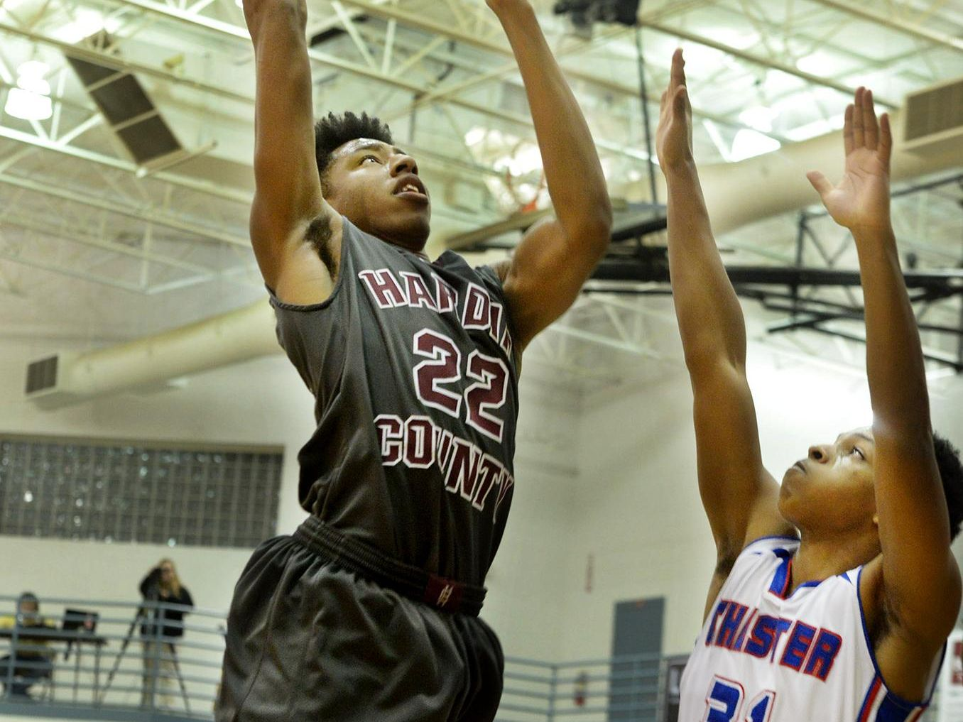 Hardin County's D'Angelo Anderson goes up for a shot over Chester County's Brennan Phelps during their game Thursday evening.