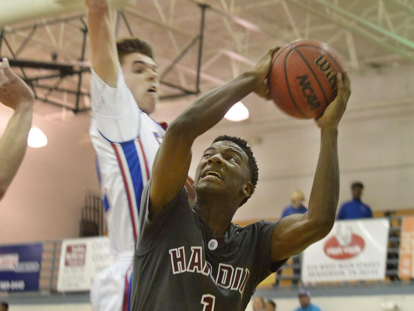 Hardin County's Antonio Davis goes up for a shot as a Chester County defender attempts to block his shot during their game Thursday evening.