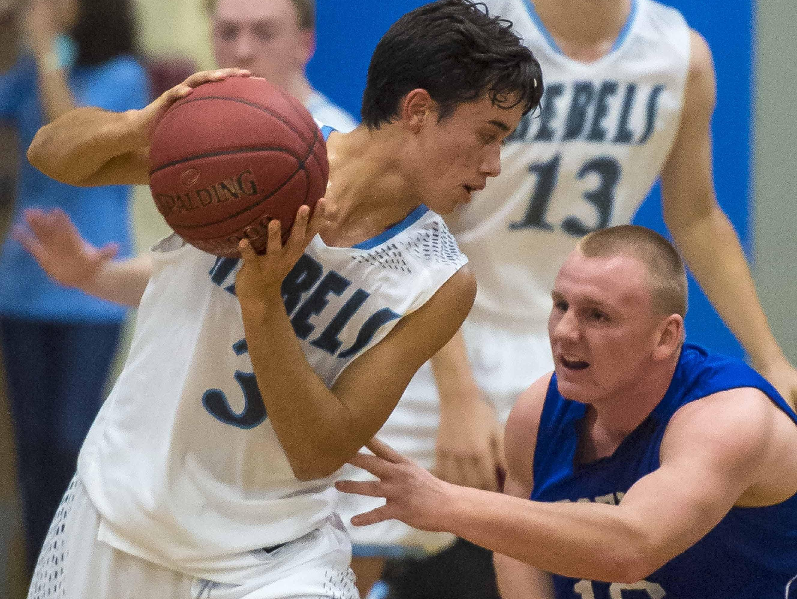 South Burlington's Ben Moran, left, is pressured by Vergennes' Devon Kimball in South Burlington on Wednesday.