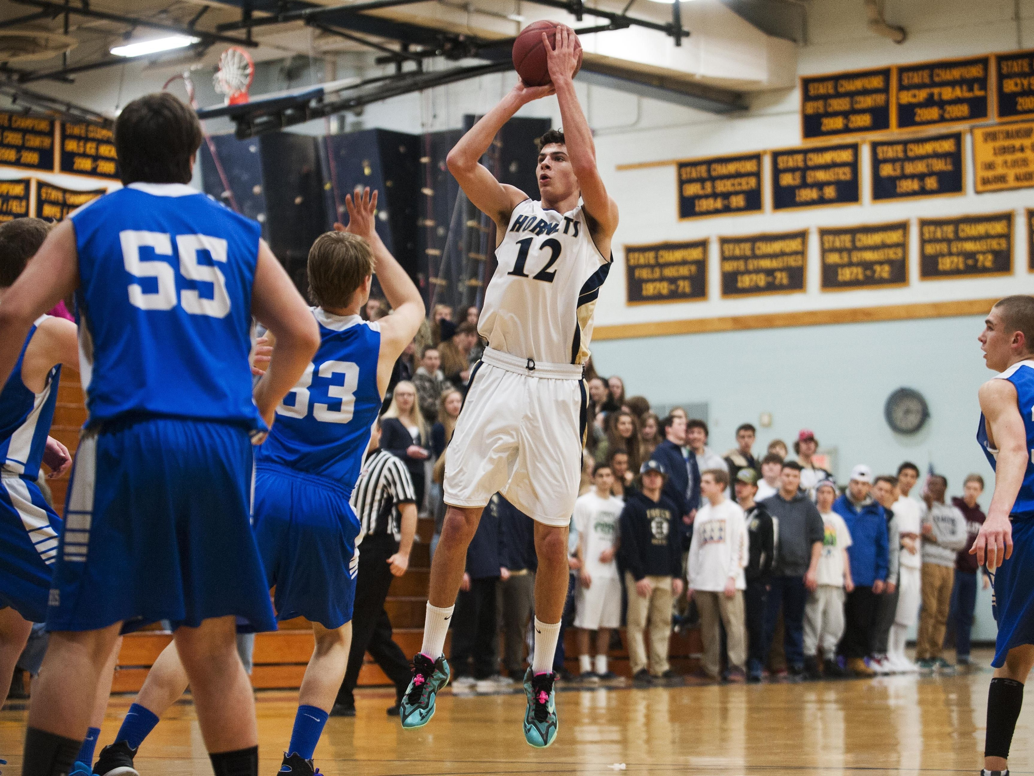 Essex's Eli DiGrande (12) takes a jump shot during the boys basketball game against Missisquoi on Tuesday night February 24 in Essex.