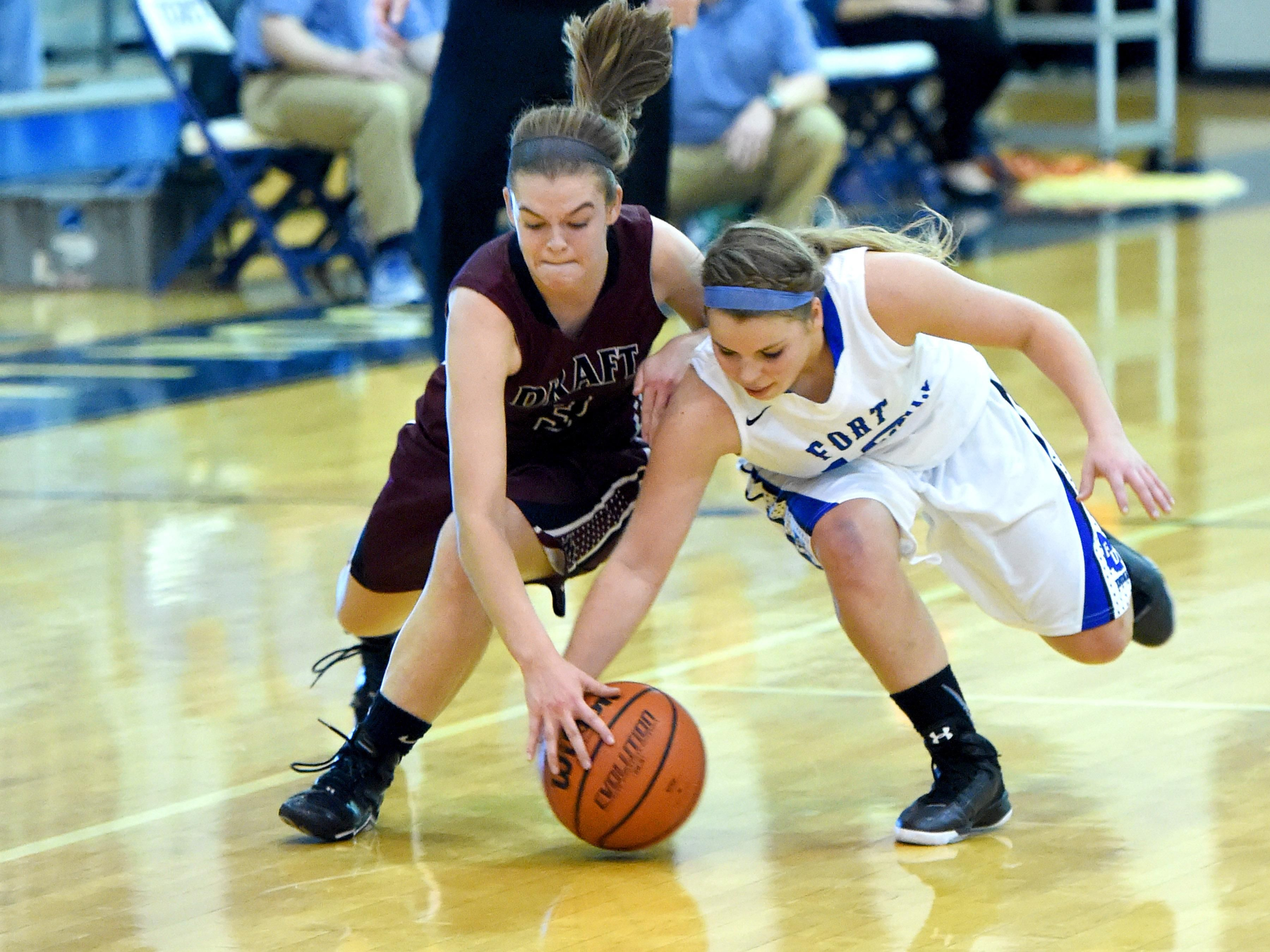 Stuarts Draft's Rachel Sauder and Fort Defiance's Lizzie Doughty chase after a loose ball during a basketball game played in Fort Defiance on Friday, Dec. 11, 2015.