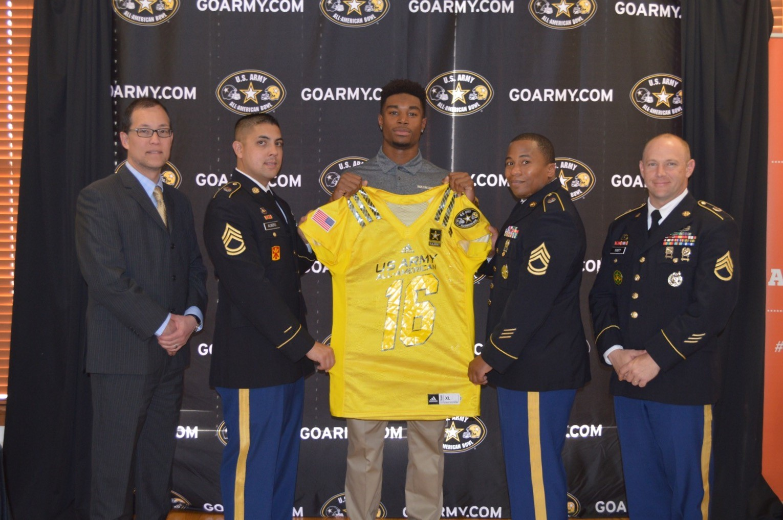 Camilo Eifler receives his Army All-American jersey from (from left): Mr. Joe Margolies, Sergeant First Class Kevin Albers, Sergeant First Class Jonathan Reed and Staff Sergeant Eric Scott (Photo: U.S. Army All-American Game)