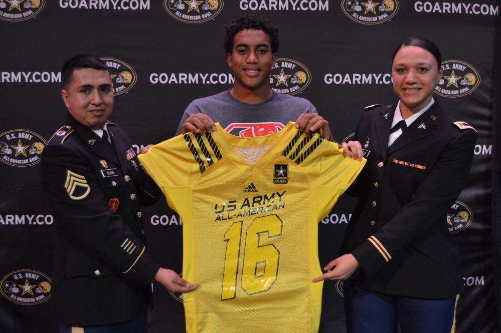 Katy, Texas, running back Kyle Porter, center, at his jersey presentation Tuesday with, left, staff Sgt. Edward Oliva and right, Second Lieutenant Adrienne Myers. (Photo: U.S. Army All-American Game).