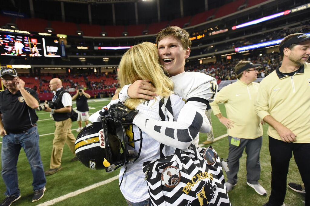 Colquitt County (Ga.) quarterback Chase Parrish celebrates the state title (Photo: Atlanta Journal Constitution via Associated Press)