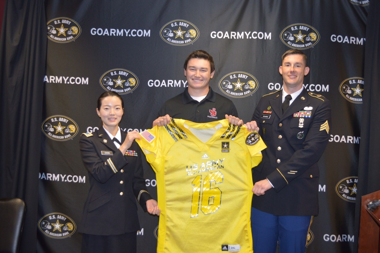 Luke Wattenberg receives his honorary Army jersey from (left) Second Lieutenant Myeongeun Chong and Sergeant Jeffrey Bruining. (Photo: U.S. Army All-American Bowl)