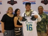 Michael Eletise shows off his Under Armour jersey with his parents (Photo: Intersport)