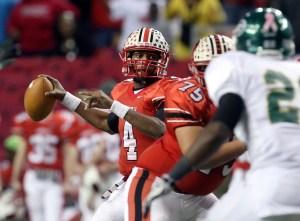 Former Gainesville (Ga.) quarterback Deshaun Watson (4) made a bold prediction about his football future as a high school sophomore. (Jason Getz, Atlanta Journal-Constitution via The Associated Press)