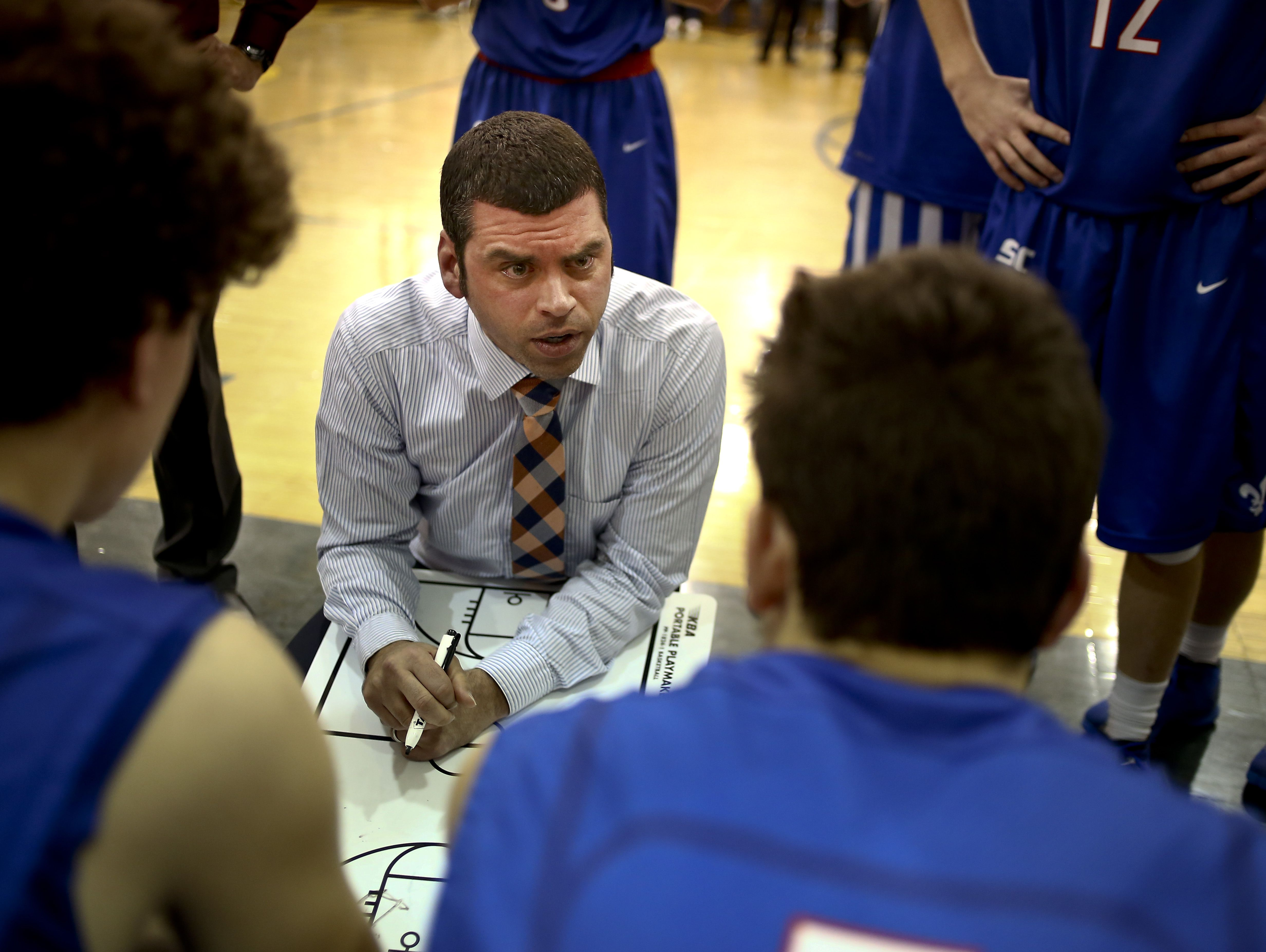 St. Clair coach Shawn Sharrow talks with players in a huddle during the Ed Peltz Holiday Basketball Tournament Friday, Dec. 18, 2015 at Port Huron Northern High School.