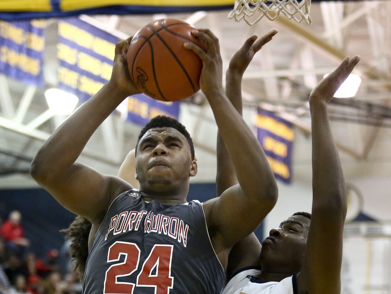 Port Huron junior Tyler Lee grabs a rebound during the Ed Peltz Holiday Basketball Tournament Friday, Dec. 18, 2015 at Port Huron Northern High School.